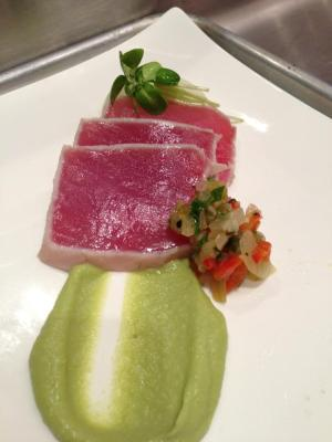 A perfectly seared Yellowfin Tuna appetizer with avocado mousse